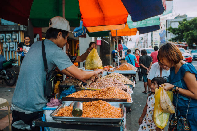A food vendor selling roasted peanuts in Bacolod City