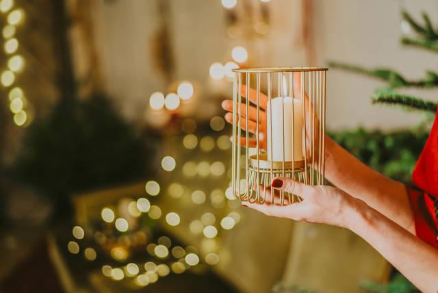 Girl Holding Candle On Christmas Lights