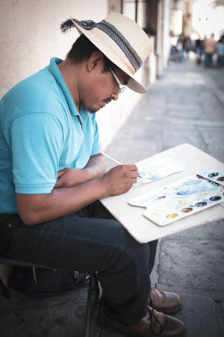 Artist painting in the streets