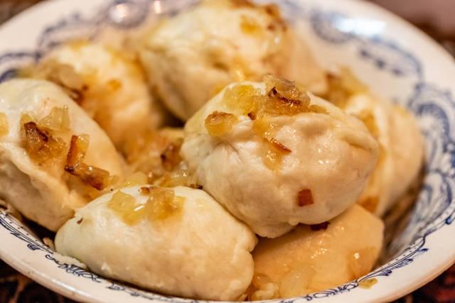 Dumplings with potatoes in plate