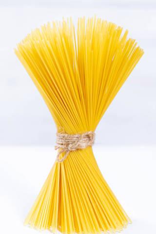 Yellow raw spaghetti