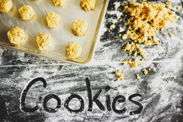 Fingerwriting over flour reading COOKIES