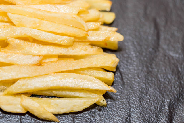 French fries on black background