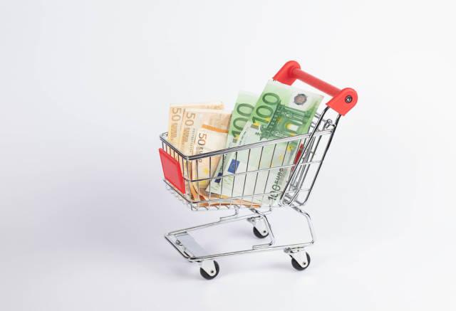 Euro banknotes in shopping cart