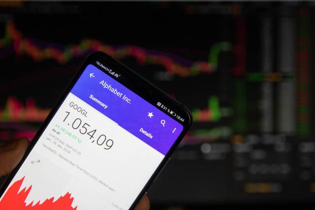 A smartphone displays the Alphabet market value