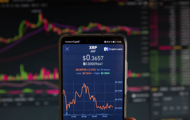 Ripple cryptocurrency price graph chart on mobile phone screen