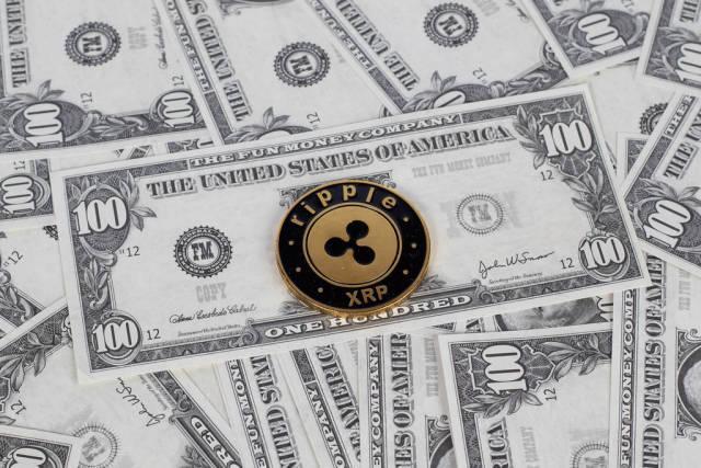 Ripple coin and dollar bills