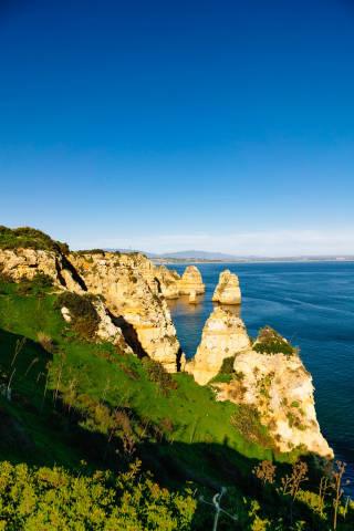 Shoreline with pillar rock formations