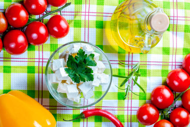 Feta cheese with vegetables and olive oil.