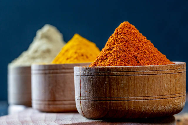 Beautiful ground spices-curcuma, paprika and ginger