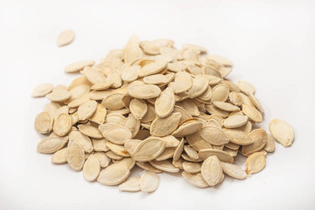 Pile of dried Pumpkin Seeds on the white background
