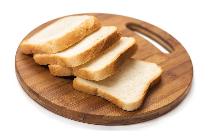 Pile of Toast bread on the round kitchen board