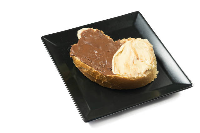 Black and white Chocolate Cream on the Bread on the square plate