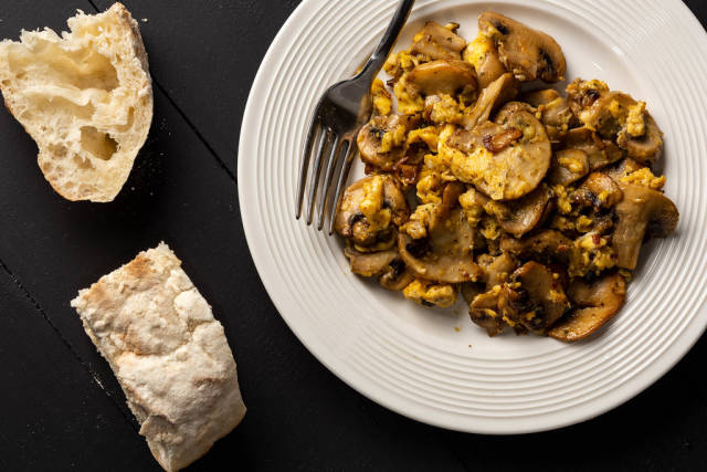 Fried Eggs and Mushrooms and Bread on the table