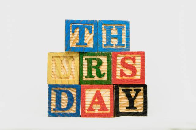 Thursday text formed on wooden blocks