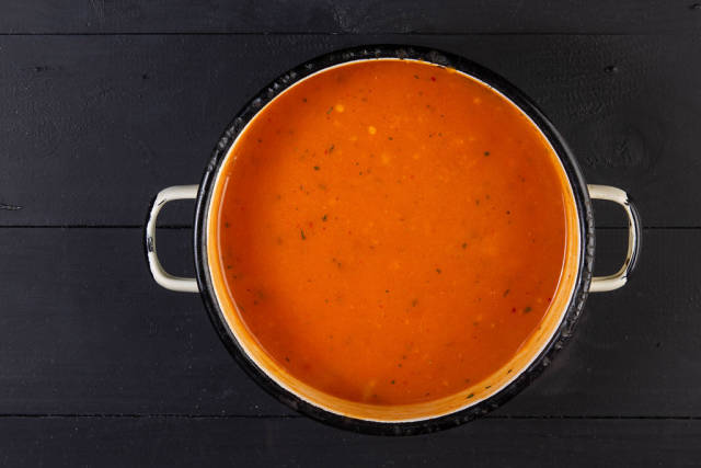 Flat lay above Tomato Sauce in the old rustic bowl