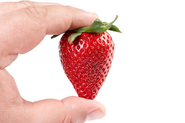 Fresh Red Strawberry in the hand