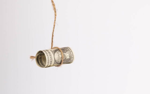 US dollar held by a rope