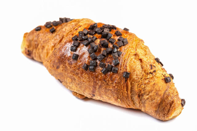 Pastry Croisant with Chocolate Crumbs above white background