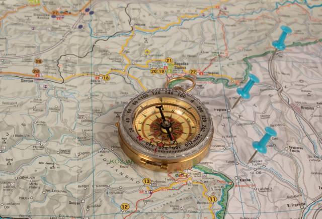 Retro compass on map