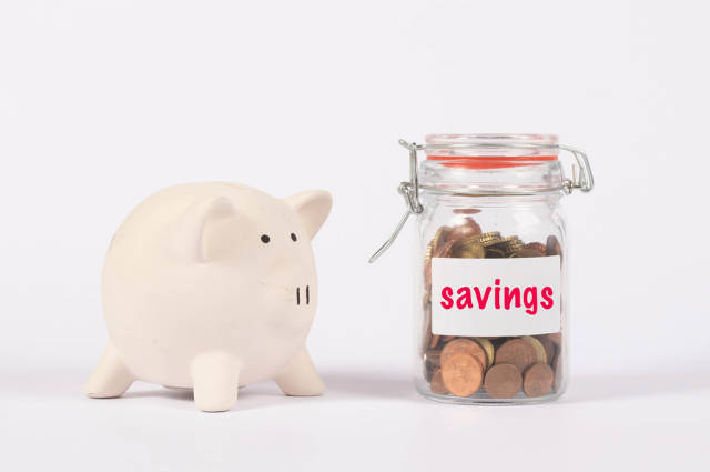 Piggy bank and money jar with savings text