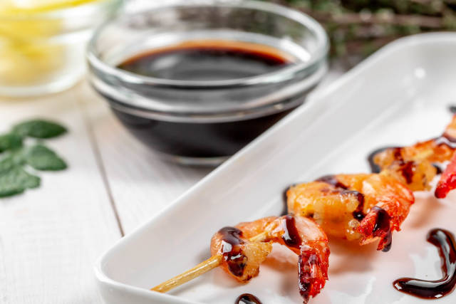 Grilled shrimp on a skewer with sauce