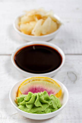 Set of traditional sauces and pickled ginger for sushi