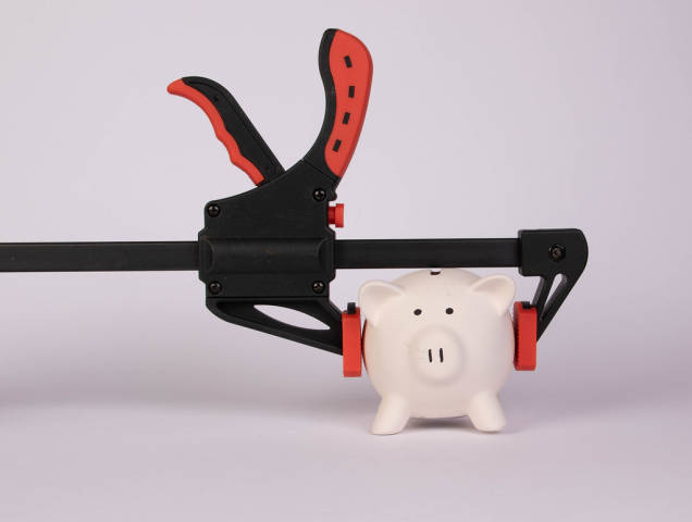 Piggy bank and clamp on white background