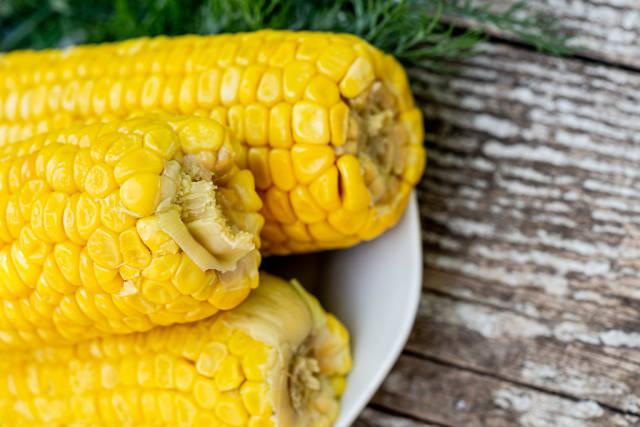 Fresh ripe boiled corn close-up