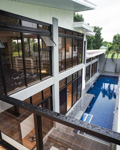 Overlooking the poolside of a new villa