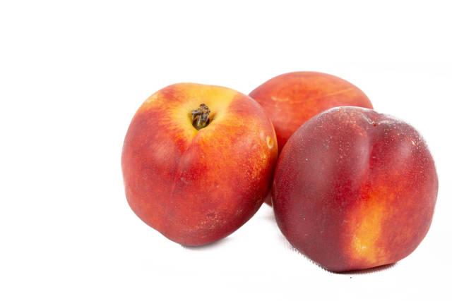Fresh Peaches isolated above white background