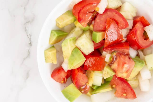 Flat lay above Avocado Tomato Onion and Cucumber Salad