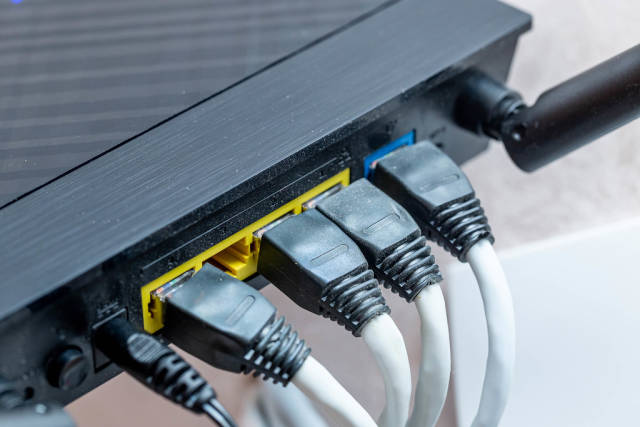 Modern wireless wi-fi router with wires connected close up