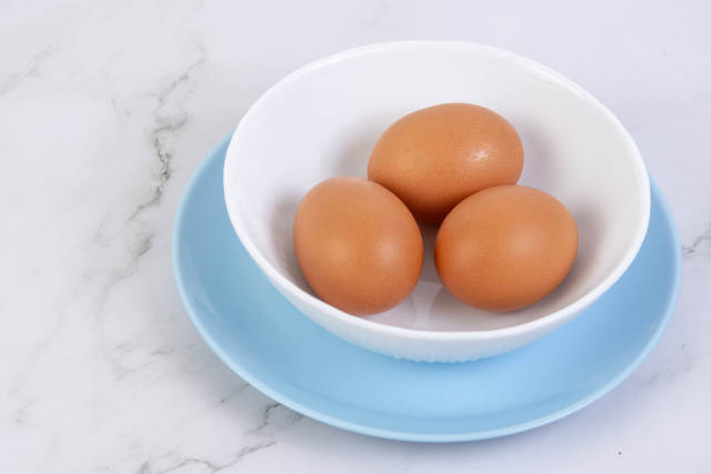 Hard Boiled Eggs in the bowl above grey marble table