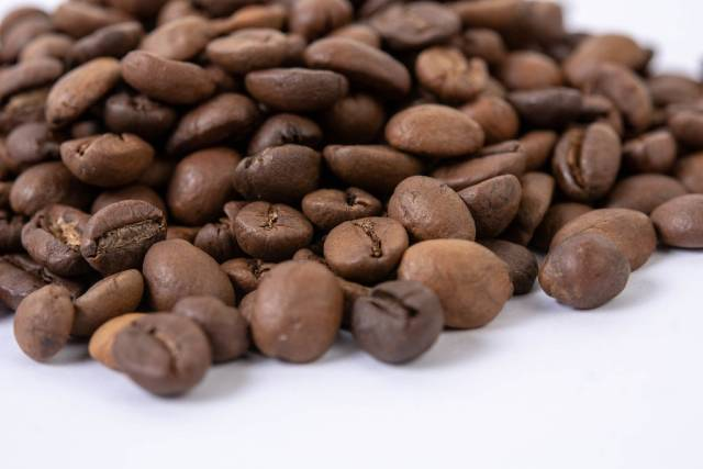 Macro fo Raw Coffee Beans on the white background (Flip 2019)