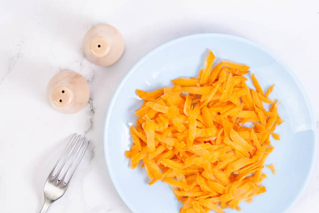 Flat lay above Grated Carrot on the plate