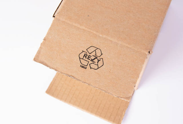 Recycle symbol on cardboard