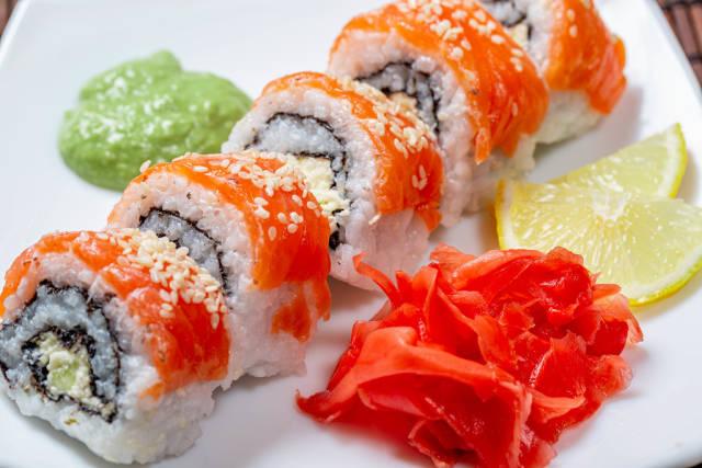 Philadelphia sushi homemade with wasabi, ginger and lemon slices