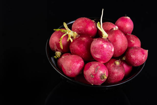 Healthy Fresh Red Radishes above black background