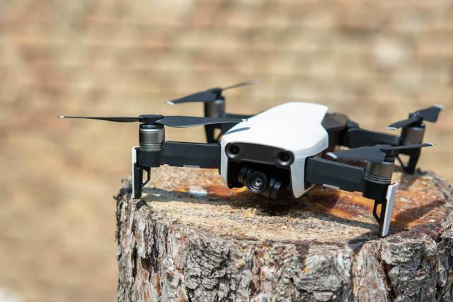 DJI Mavic Air drone parked on the tree stump