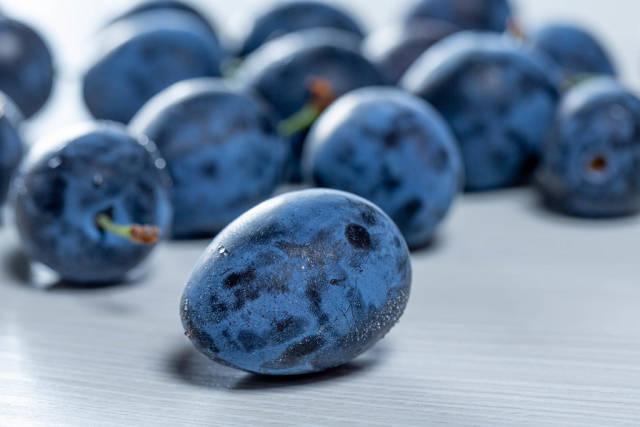 Ripe fresh blue plums close up
