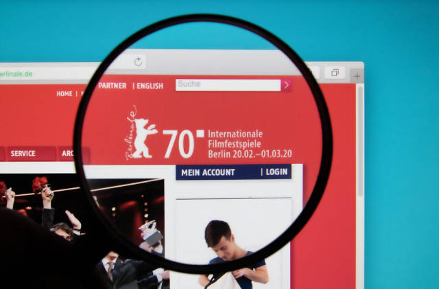 Berlinale logo on a computer screen with a magnifying glass