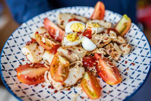 Close Up Of Calamar Tomatoes Seafood Salad