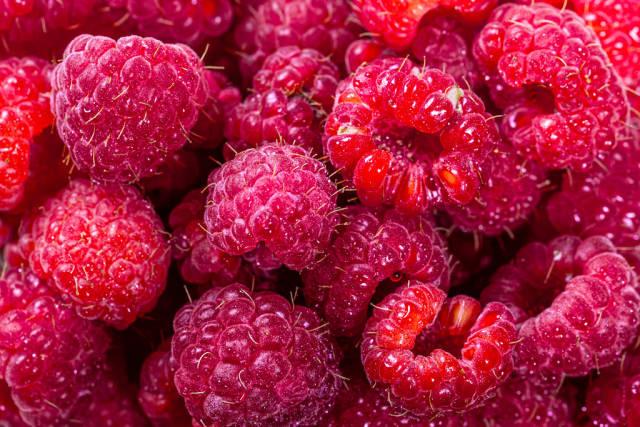 Fresh ripe raspberry background. Close up