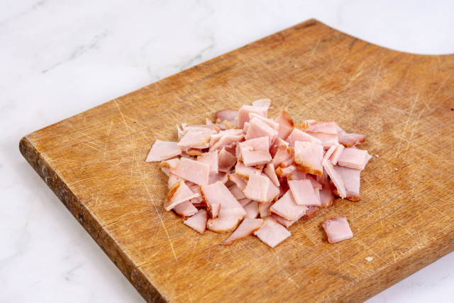 Sliced Ham on the wooden cutting board