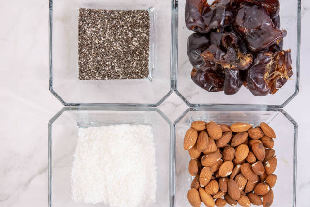Top view of Peanut butter Almonds Coconut Chia Seeds and Dates