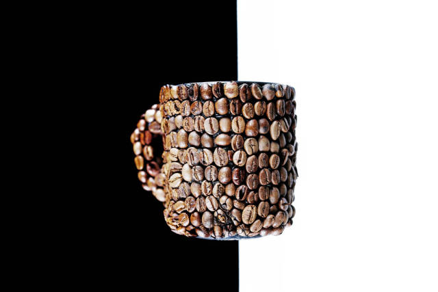 Coffee beans cup, background split in black and white