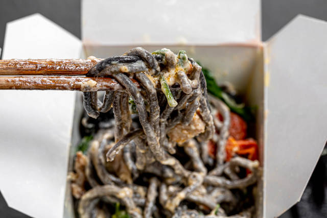 Close up of Chinese noodles with cuttlefish ink