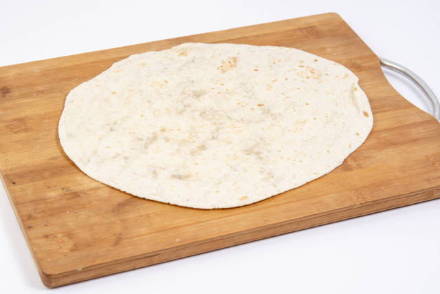 Tortilla on the wooden kitchen board