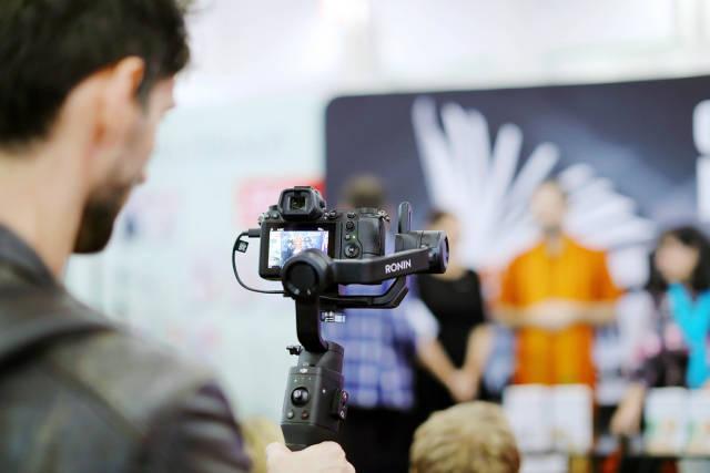 Man video recording using Ronin handheld stabilizer